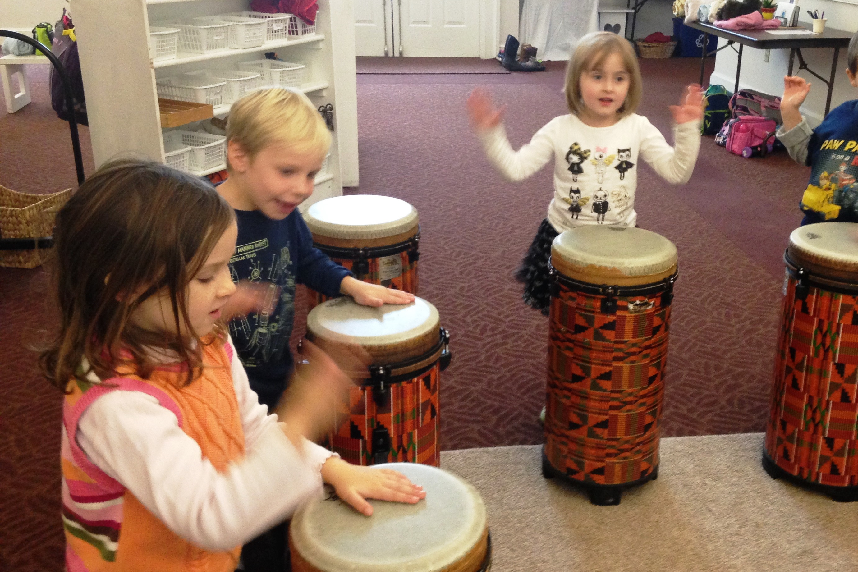 children drumming montessori preschool
